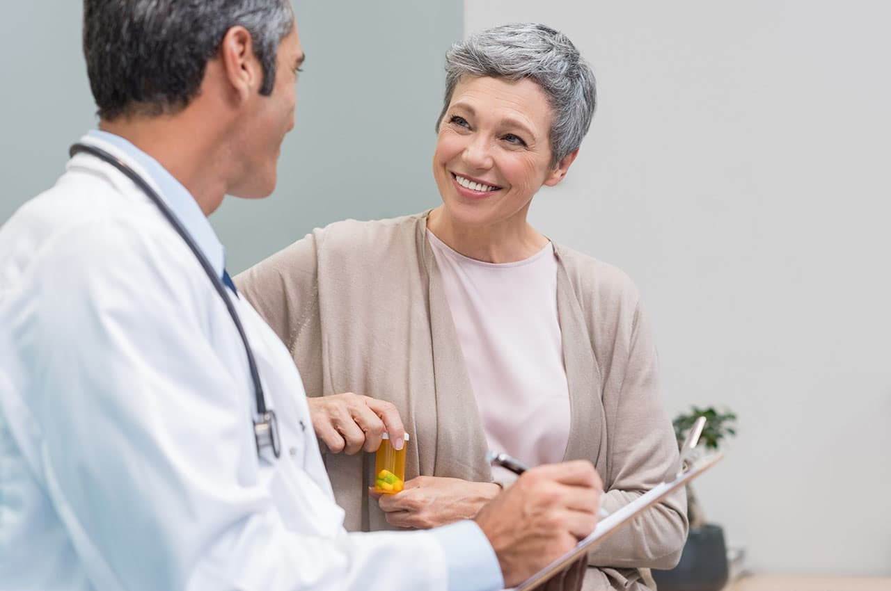 10 things about medicare, woman talking to doctor