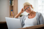 Woman viewing website open enrollment deadline Your Insurance Gal