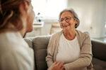 Woman explaining to senior how medicare benefits you